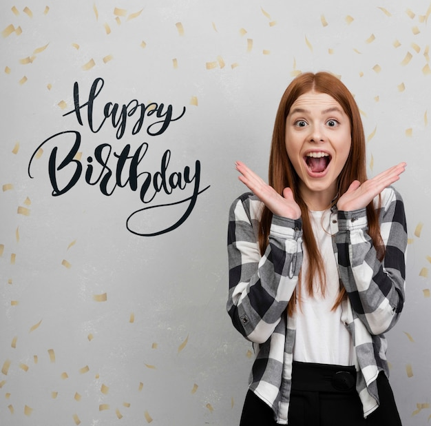 Excited woman with birthday mock-up
