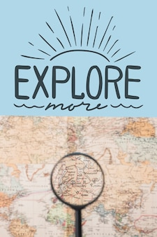 Explore more, lettering with world map and magnifying glass