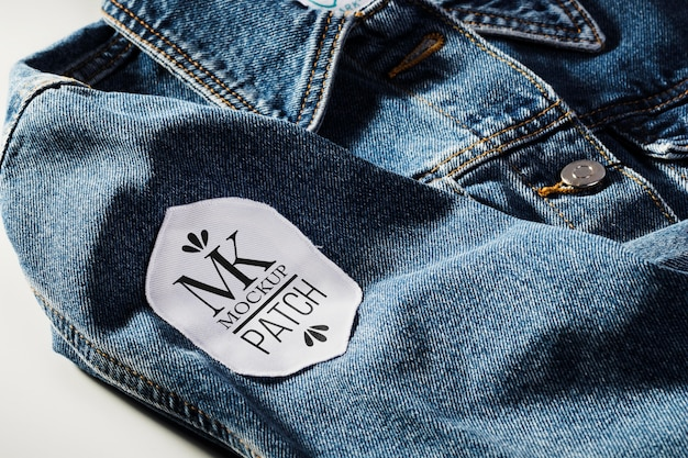 Fabric clothing patch mock-up on denim material
