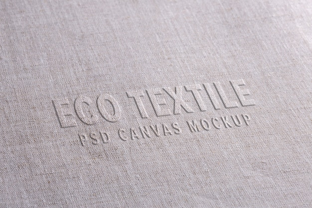 Fabric logo mockup on white linen cloth. natural surface with displaced text style