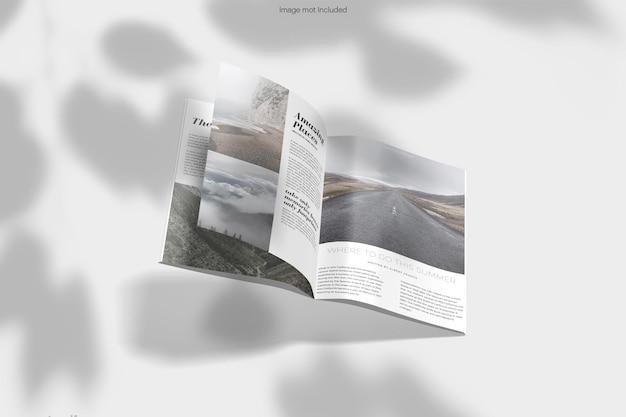 分離された雑誌のモックアップデザインのレンダリングをフォールダウン