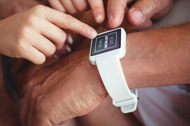 Family pointing at smart watch