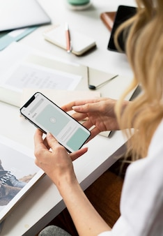 Fashion stylist using a mobile phone mockup at work