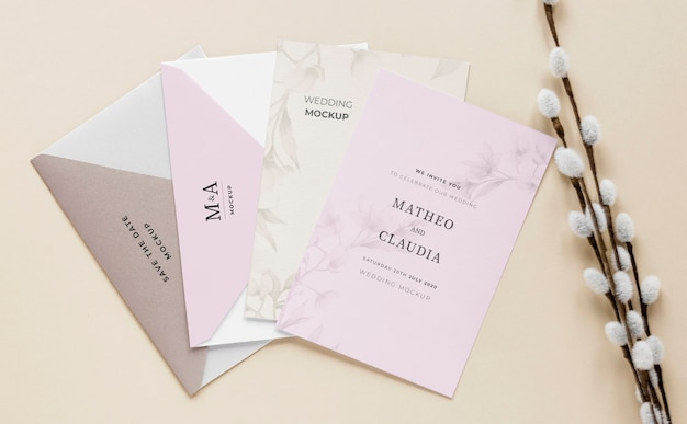 Fat lay of wedding cards with flowers