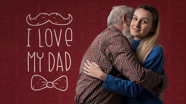 Отец и дочь обнимаются на бордовом фоне