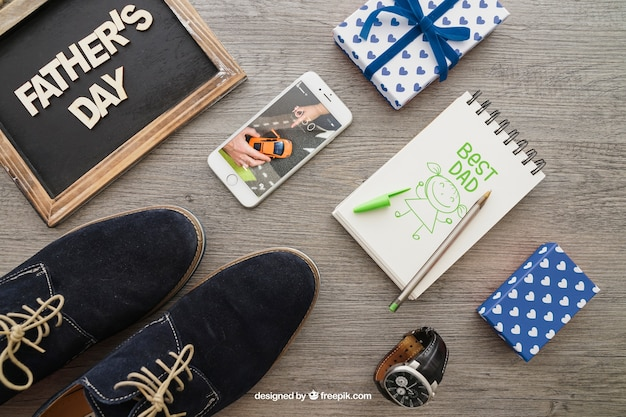 Father's day composition with notepad and shoes