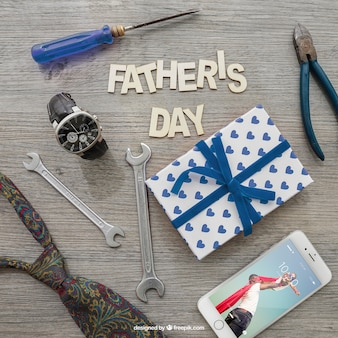 Father's day lettering, smartphone, gift box and tools
