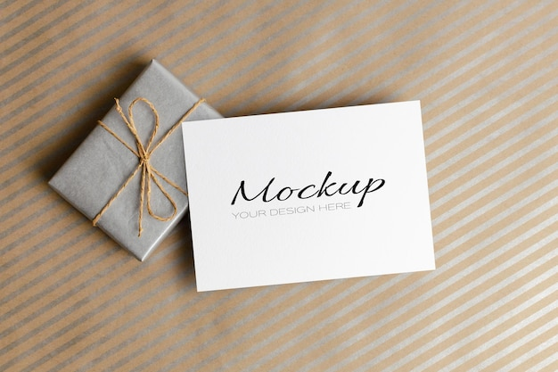 Fathers day or birthday greeting card mockup with gift box on striped background