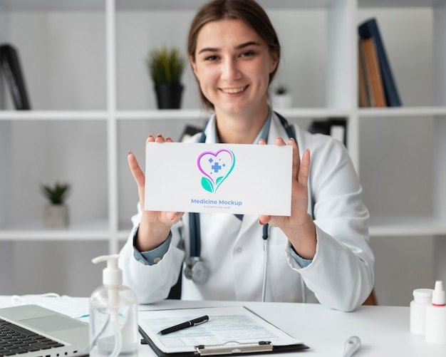 Female doctor holding a mock-up card