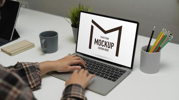 Female freelancer working with mock up laptop