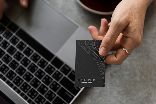 Female hand holding a business card mockup