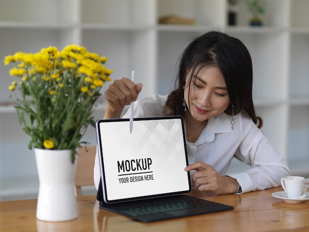 Female office worker presenting with tablet mockup