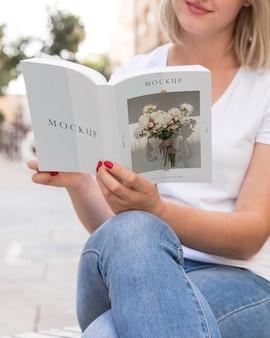 Female on street reading book