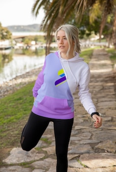 Female wearing hoodie exercising