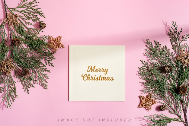 Festive christmas mock-up card with fir twigs and stars.
