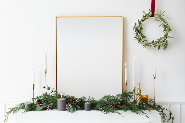 Festive golden photo frame against a white wall