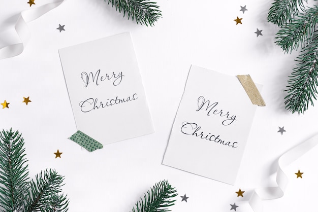 Fir branches frame with christmas mockup cards on white