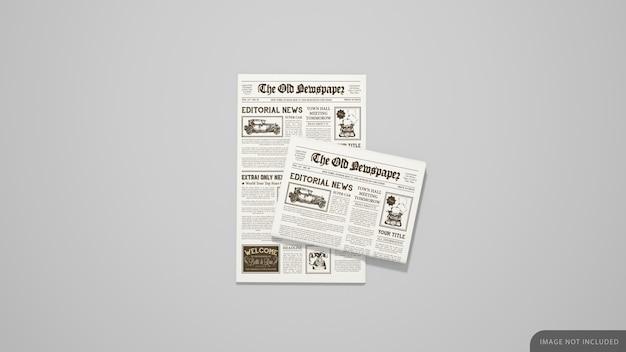 最初のページと折りたたまれた新聞のモックアップ