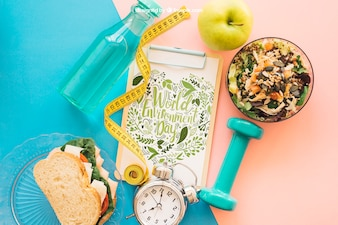 Fitness mockup with clipboard and salad
