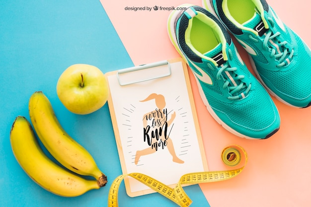 Fitness mockup with clipboard, shoes and banana