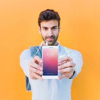 Fitness mockup with man showing smartphone