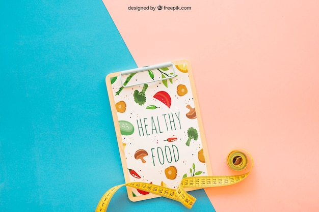 Fitness mockup with tape measure on clipboard