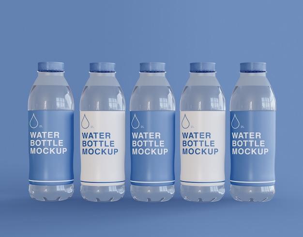 Мокап пяти пластиковых бутылок с водой