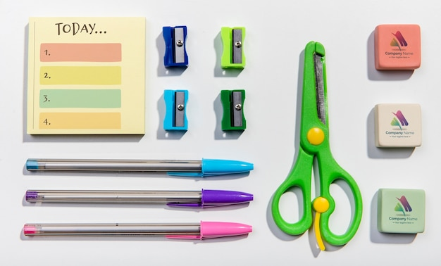 Flat lay arrangement of school supplies knolling desk concept