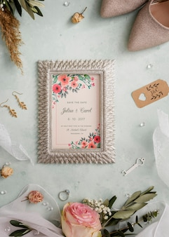Flat lay arrangement of wedding elements with frame mock-up