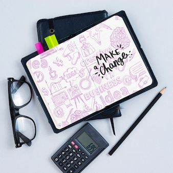 Flat lay arrangement with calculator and notebook