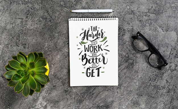 Flat lay arrangement with notebook on stone background