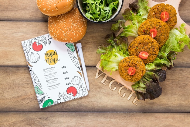 Flat lay arrangement with tasty food on wooden table