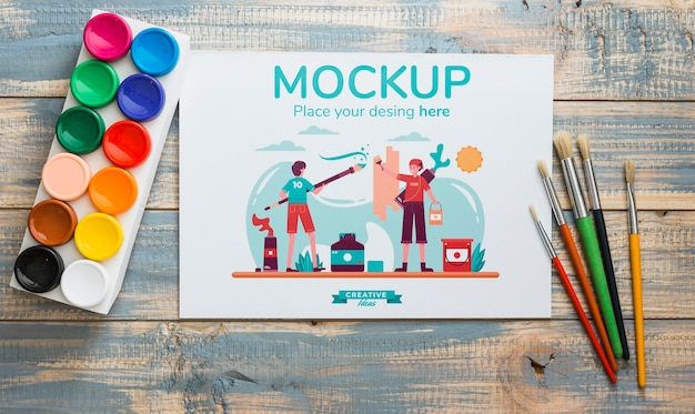 Flat lay artist concept arrangement with card mock-up