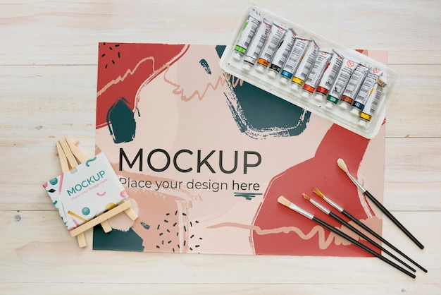 Flat lay artist concept assortment with paper mock-up