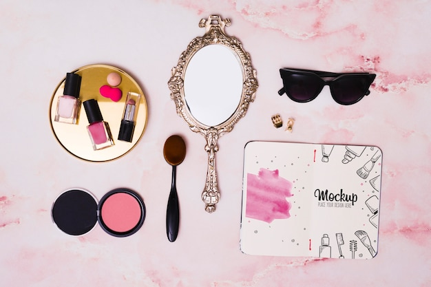 Flat lay assortment of make-up and mirror mock-up