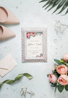 Flat lay assortment of wedding elements with frame mock-up
