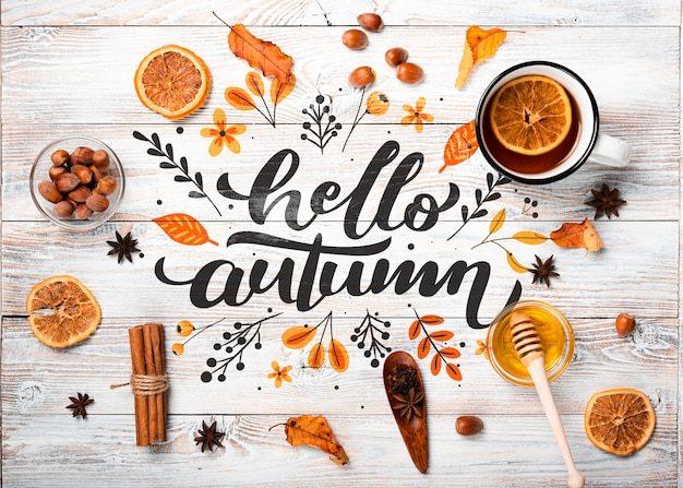 Flat lay autumn arrangement on wooden background