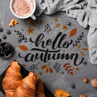 Flat lay autumn breakfast on stucco background