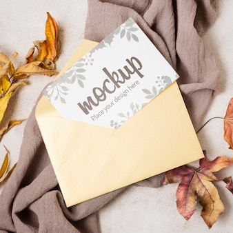 Flat lay autumn mock-up with leaves on grey cloth