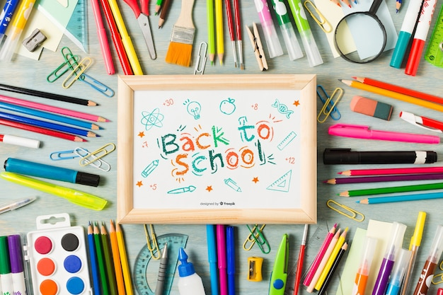 Flat lay back to school board with crayons