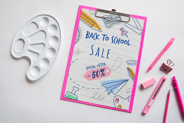 Flat lay back to school sale with clipboard and supplies