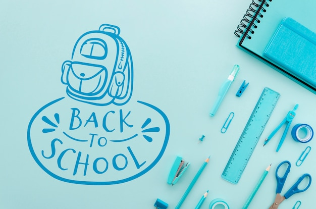 Flat lay back to school with blue supplies