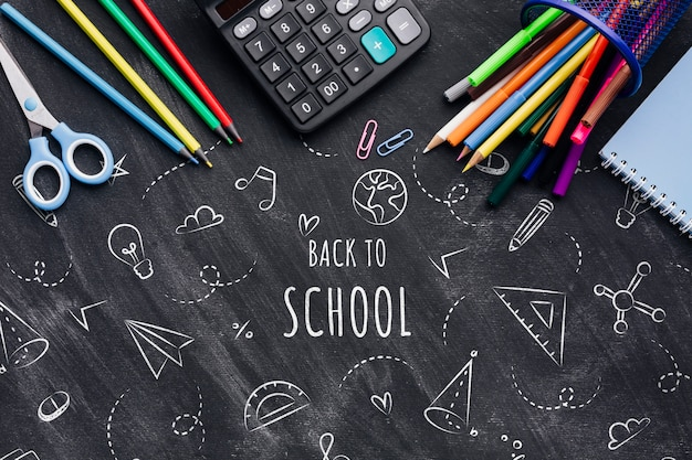 Flat lay back to school with chalk drawings