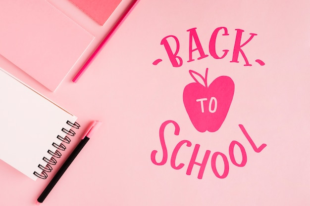 Flat lay back to school with pink background