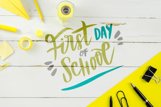 Flat lay back to school with wooden background