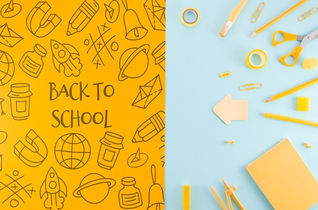 Flat lay back to school with yellow supplies