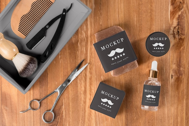 Flat lay of barbershop products with scissors and serum