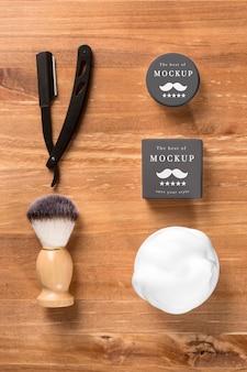 Disposizione piatta di prodotti da barbiere
