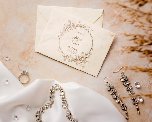 Flat lay beautiful arrangement of wedding elements with card mock-up