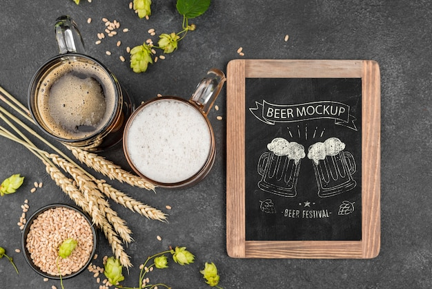 Flat lay of beer glass with pint and chalkboard